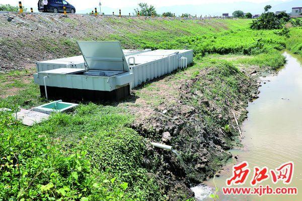 黄布沙村已投入使用的一体化污水处理设备。 西江日报通讯员供图