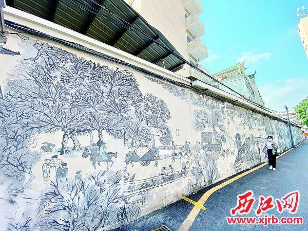 """端州区光明街正巷的主题墙绘《阅江民居图》,被称为 """"肇庆版《清明上河图》""""。"""